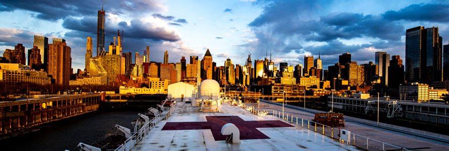 Navy medical ship deck with New York City skyline