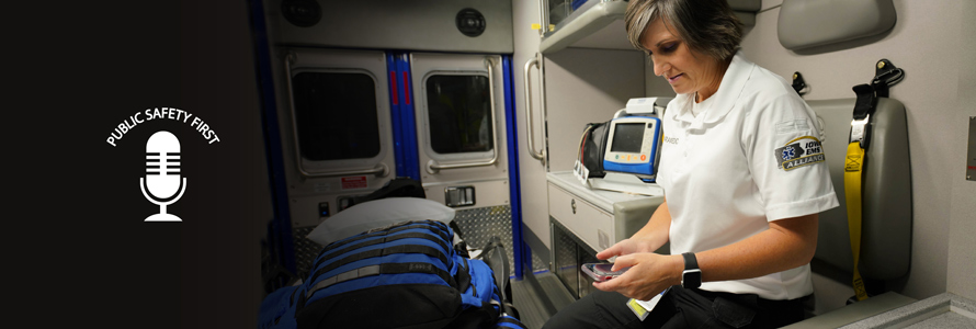 Public Safety First podcast logo; EMS official sits in ambulance and holds smartphone in hand