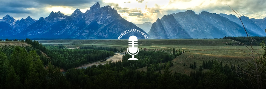 Mountain range with forest; Public Safety First podcast logo