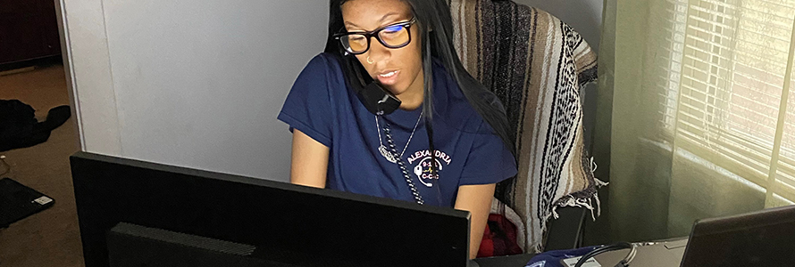 An Alexandria call-taker talks on the phone while looking at her computer