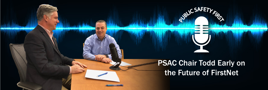 PSAC Chair Todd Early and Dave Buchanan talk into a microphone in front of a graphic representation of a soundwave.