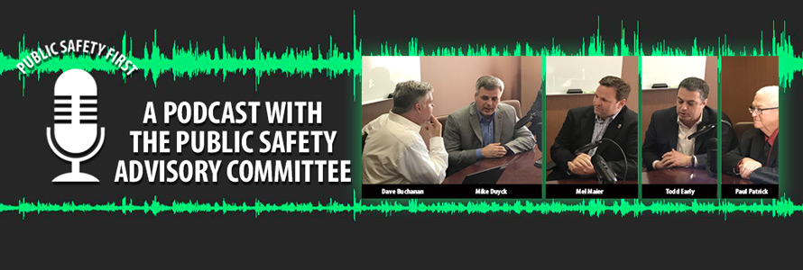 Representatives of the FirstNet Authority Public Safety Advisory Committee speak to Dave Buchanan