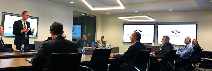FirstNet Board members sit and listen to a presentation during a visit the Georgia Cyber Center