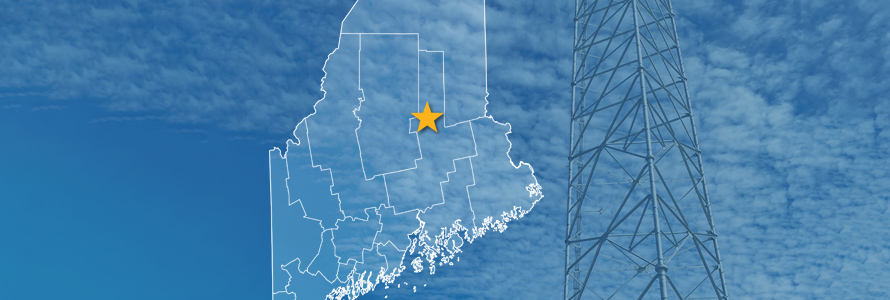 The State of Maine, with outlined county borders and star locating Millinocket, Maine; a cell tower.