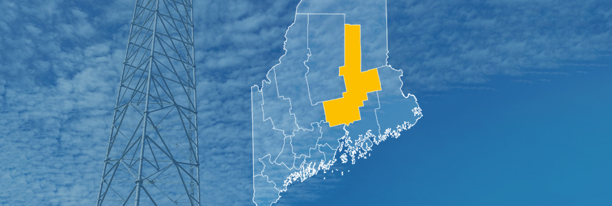 The state of Maine, with outlined county borders; a cell tower.