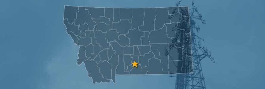 The state of Montana, with outlined county borders with a star locating Columbus, Montana; a cell tower.