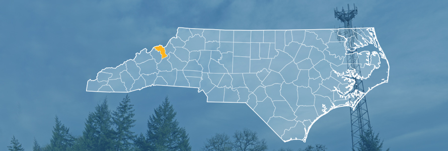 The state of North Carolina, with outlined county borders; a cell tower.