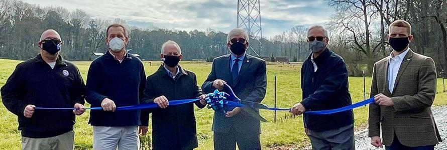 Community representatives cut a ribbon near new FirstNet cell site near Moore County, North Carolina.