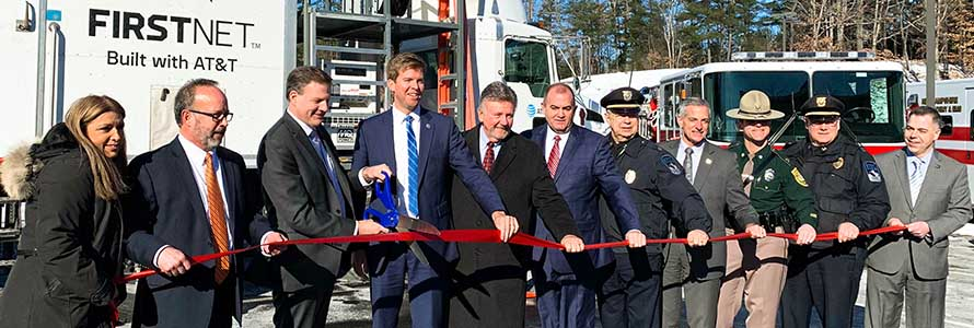 Ed Parkinson of the FirstNet Authority and New Hampshire Governor Chris Sununu cut a red ribbon at the launch of several FirstNet towers