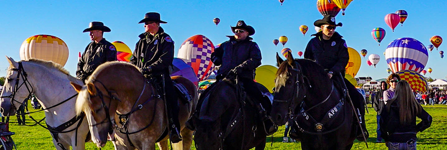 Four officers on horses during the Albuquerque International Balloon Fiesta