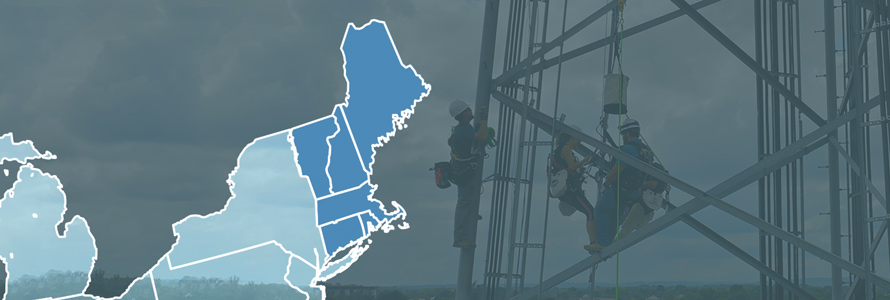 Map of New England with Maine, New Hampshire, Vermont, Massachusetts, Connecticut, and Rhode Island highlighted; workers on a cell tower above the treetops.