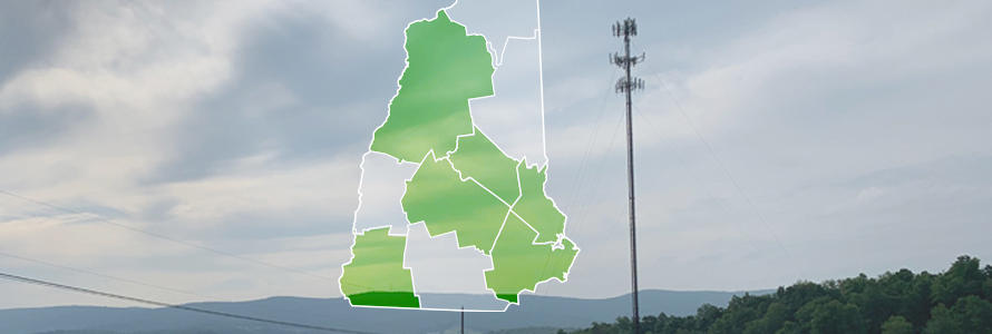 The state of New Hampshire, with outlined county boarders; a cell tower.