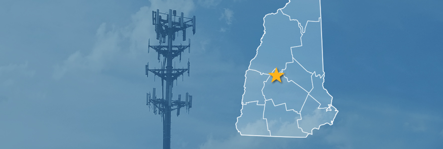 The State of New Hampshire, with outlined county borders and star locating Danbury, New Hampshire; a cell tower.
