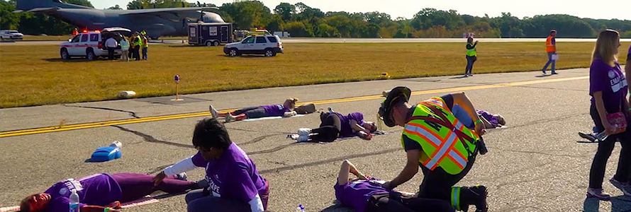 During a large-scale incident at an airport, first responders are attending crash victims on runway.