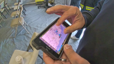 An officers holds a FirstNet device used to track severe weather events and share real time data with responders.
