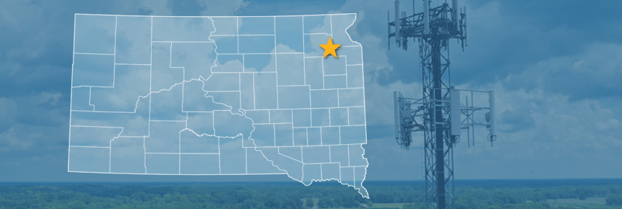 The state of South Dakota, with outlined county borders and star locating cell site; a cell tower.