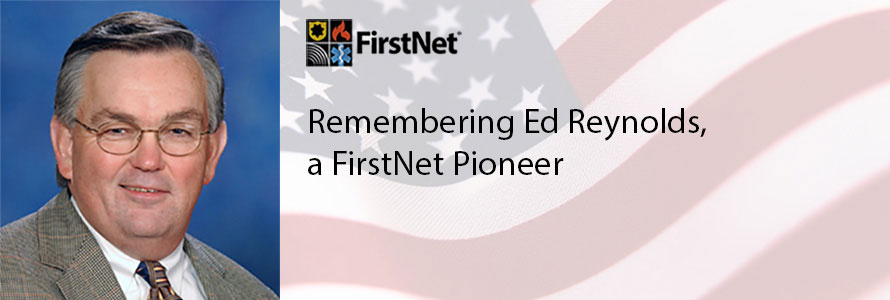 """A photo of Ed Reynolds, accompanied by the American flag and the words """"Remembering Ed Reynolds, A FirstNet pioneer"""""""