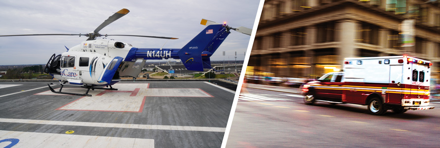 A University of Mississippi Medical Center helicopter on the roof of a medical facility and an ambulance driving on a city street.