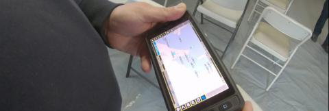 First responder hlding a cell phone viewing a map
