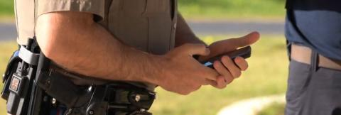 Law enforcement officer using smart device