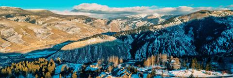 Aerial view of lodges and snow-covered mountains during the day in Eagle County, Colorado