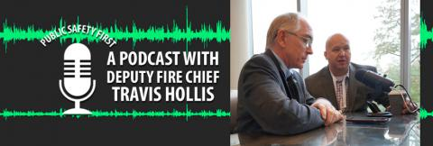 Deputy Chief Travis Hollis of the Rogers Fire Department speaks with Michael Varney