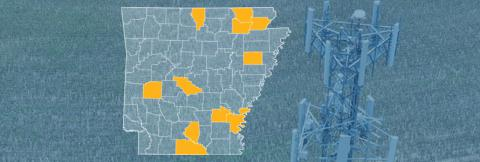 The state of Arkansas, with outlined county borders; a cell tower.