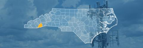 The state of North Carolina, with outlined county borders; a cell tower