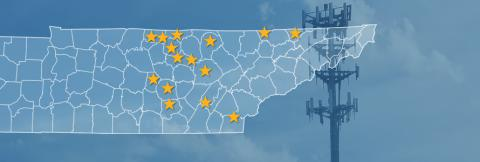 The state of Tennessee, with outlined county borders and 15 stars locating towns; a cell tower.