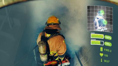 A firefighter in safety gear with a tank on his back descends stairs into a smoke filled area.