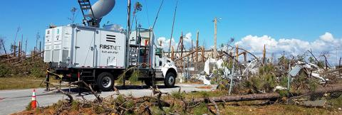 An AT&T SatCOLT is setup among damage from Hurricane Michael