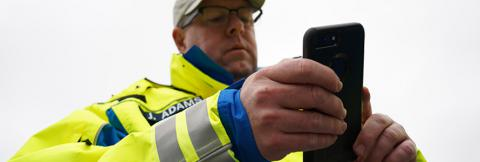 First responder holds smartphone
