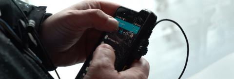 A first responder uses an application on a smartphone.