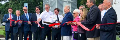 Maryland Delegate Johnny Mautz, FirstNet Authority Board Member David Zolet and others cut a red ribbon to celebrate a new cell site in Tilghman Island
